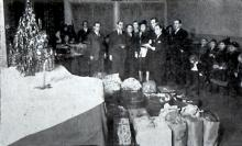 Distribution of gifts to the needy highlighted the Christmas program in 1940.